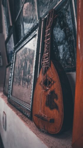 A historical lute propped next to an old painting