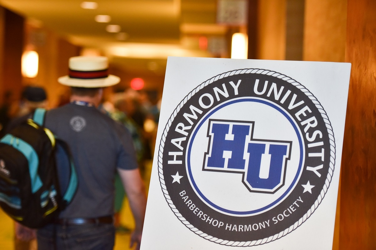 Hu Logo Man With Backpack