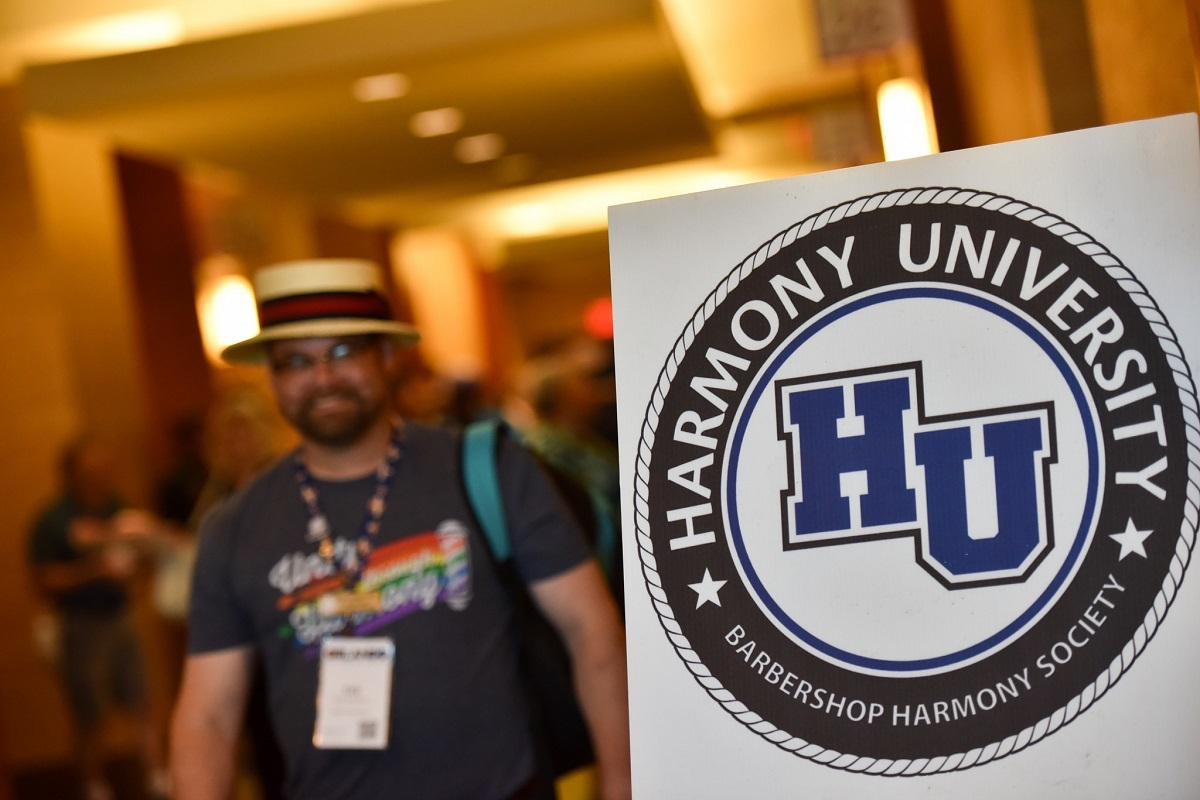 Hu Logo Man With Barbershop Hat