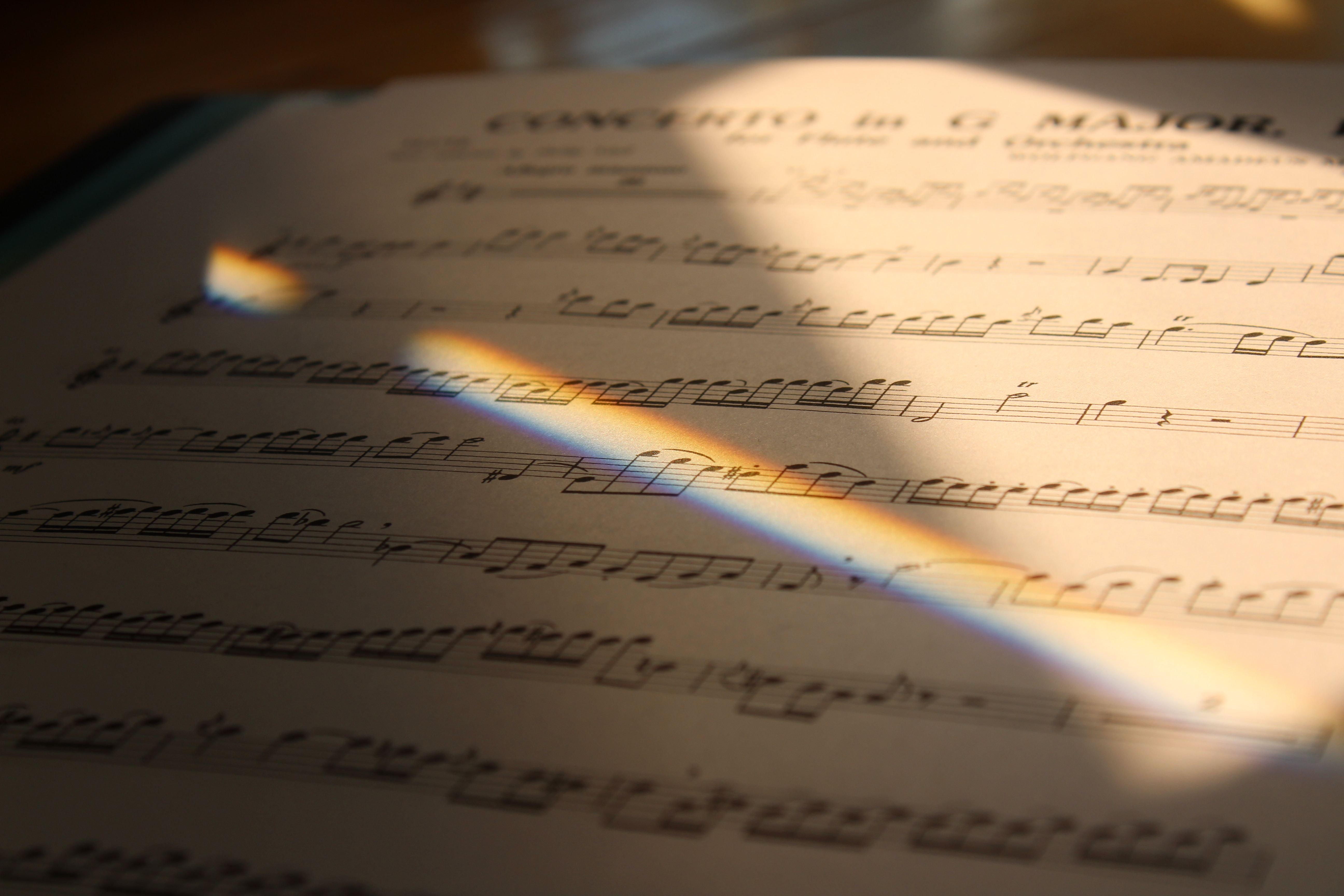 Sheet Music with rainbow light shining on it